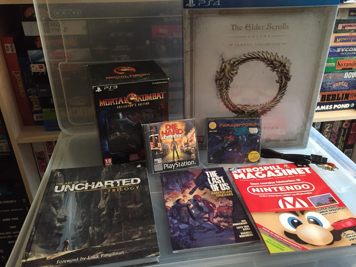 Mortal Kombat Collectors Edition, Elder Scrolls Online Unlimited edition, Die Hard Trilogy 2, NovaStorm, Uncharted trilogy Art book, Last Of Us Comic, Retro Magasinet and a Nintendo 64 Comp. Cable.